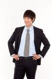 亚洲商人微笑的年轻人 免版税库存图片