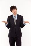 亚洲商人麻烦年轻人 免版税库存照片