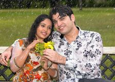 亚洲夫妇雨 库存照片