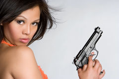 亚洲女孩枪 免版税库存照片