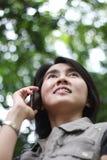 亚洲女孩电话俏丽联系 免版税库存图片