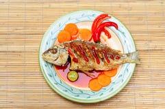 亚洲深鱼油煎的菜单 免版税库存图片