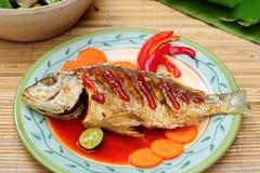 亚洲深鱼油煎的菜单 库存照片