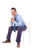 亚洲生意人坐椅子 免版税库存图片
