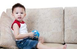 亚洲男孩玩具 库存照片