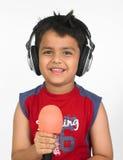 亚洲男孩耳机 免版税库存照片