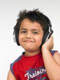 亚洲男孩耳机 库存照片