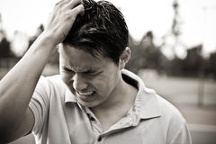 亚洲男性哀伤的强调的年轻人 库存图片