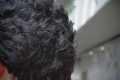 亚洲男性的特写镜头黑卷发 图库摄影