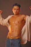 亚洲男性肉欲 库存图片