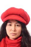 亚洲盖帽女孩红色 免版税库存照片