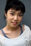 亚洲纵向俏丽的妇女 免版税库存图片