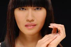 亚洲美好的秀丽典雅的射击妇女 库存照片