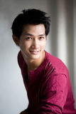 亚洲英俊的微笑 免版税库存照片