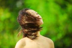 亚洲轻打头发 免版税库存图片