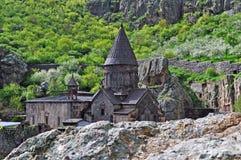 亚美尼亚人倾斜的Geghard修道院 免版税库存照片