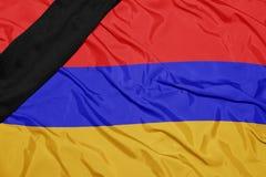 亚美尼亚的国旗有黑哀悼的丝带的 库存图片