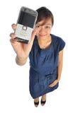 亚裔中国女孩她的移动电话陈列 图库摄影