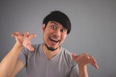 亚裔人做滑稽的可怕面孔 库存照片