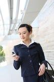亚裔企业移动电话妇女 免版税图库摄影