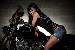 亚裔可爱的摩托车骑马三十妇女 库存照片