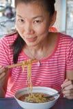 亚裔吃的妇女 图库摄影