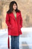亚裔外套红色妇女 免版税库存图片