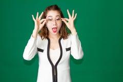 亚裔夫人滑稽的行动 图库摄影