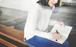 亚裔夫人Writing Notebook Diary Concept 免版税库存图片