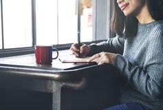 亚裔夫人Writing Notebook Diary Concept 库存照片