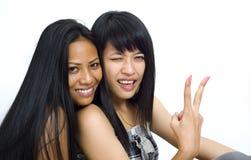 亚裔女孩二个年轻人 图库摄影