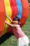 亚裔女孩使用的一点 免版税库存图片