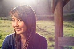 亚裔女孩在公园 免版税图库摄影