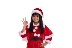 亚裔女孩在圣诞老人随员 库存图片