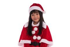 亚裔女孩在圣诞老人随员 免版税库存照片