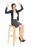 亚裔女孩坐椅子 免版税库存图片