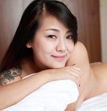 亚裔女孩室内纵向 免版税图库摄影