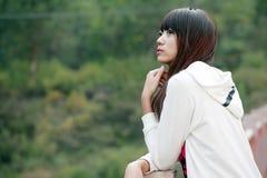 亚裔女孩室外纵向 免版税图库摄影