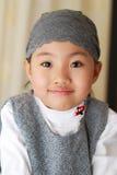 亚裔女孩微笑的一点 免版税库存图片