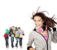 亚裔女孩愉快微笑 免版税图库摄影