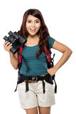 年轻亚裔女孩有与knapshack和双筒望远镜 图库摄影