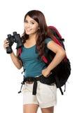 年轻亚裔女孩有与knapshack和双筒望远镜 库存图片