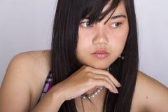 亚裔女孩的面孔有蓝眼睛的 免版税库存图片