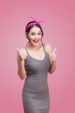 亚裔女孩画象有俏丽的微笑的在与韩的画报样式 库存图片