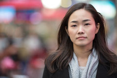 亚裔妇女严肃的面孔画象 免版税库存照片