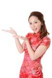 亚裔妇女介绍 免版税图库摄影