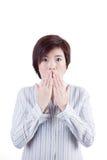 亚裔妇女吓唬与某事 免版税库存图片