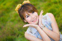 亚裔妇女微笑  图库摄影