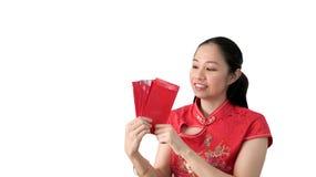 亚裔妇女愉快的面孔春节红色传统costime 库存图片