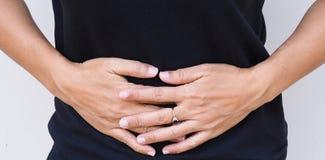 亚裔妇女有胃肠痛苦 库存图片